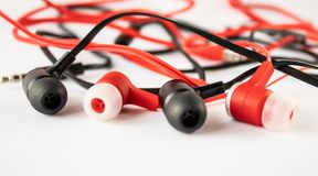 Black and red headphones on white background stock photography
