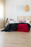 Black and red interior accents. Black and red accents in minimal bedroom interior Stock Photos