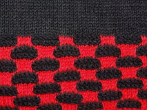 Black and red knitted fabric Stock Photos