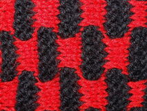 Black and red knitted fabric Stock Photography