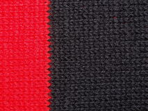 Black and red knitted fabric Stock Images