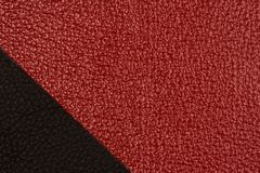 Black and red natural leather texture closeup. Stock Photo