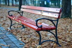 Black and Red Park Bench Near Grey Concrete Pathway Royalty Free Stock Photo