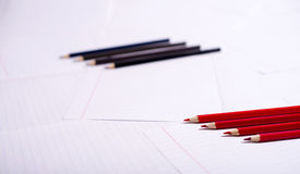 Black and red pencils exactly lie Royalty Free Stock Photography
