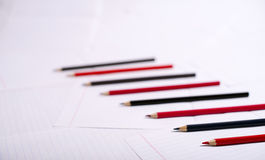 Black and red pencils lie exactly serially Stock Images