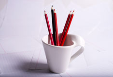 Black and red pencils standcup Stock Images