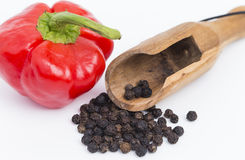 Black and red pepper. With spoon isolated on white background royalty free stock image
