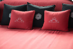Black and red pillows placed on sofa. Cushion Stock Photography