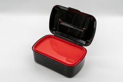 Black and red plastic box isolated on white stock photography