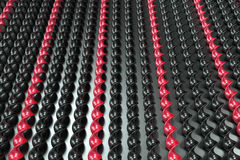 Black and red plastic spiral sticks on black background. Abstract background. 3D render illustration Stock Photo