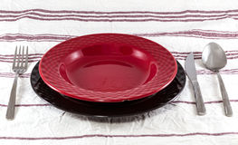 Black and Red Plate and Cutlery Royalty Free Stock Image