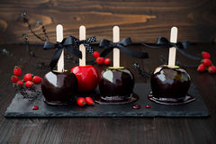 Black and red poison caramel apples. Traditional dessert recipe for Halloween party. Royalty Free Stock Photography