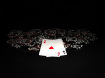 Black and red poker chips and aces Royalty Free Stock Photos