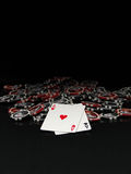 Black and red poker chips and cards. Isolated on black background Stock Photo