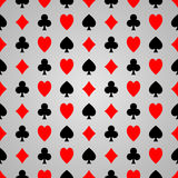 Black and red poker suit on grey background stock photo