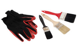 Black-red protective glove and brush tool Royalty Free Stock Images
