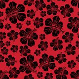 Black on red random hibiscus flower seamless repeat pattern background. Two colour random hibiscus flower seamless repeat pattern background. Could be used for Royalty Free Stock Image