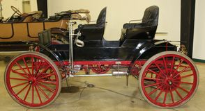 Black and Red 1911 Sears Buggy Style Vehicle Stock Image