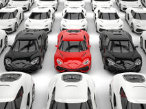 Black and red sports cars amongst many white cars Stock Photography