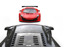 Black and red supercars facing each other - black car FPS view Royalty Free Stock Photography
