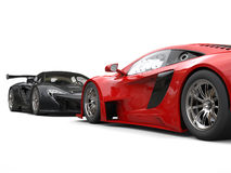 Black and red supercars facing each other - focus on red car Royalty Free Stock Photo