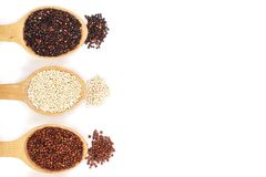 Black red white quinoa seeds in wooden spoon isolated on white background with copy space for your text Stock Photo