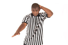 Black referee calling an offensive foul Royalty Free Stock Photo