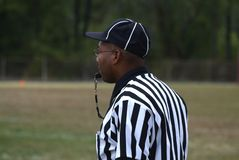 Black referees a game  at a high school football royalty free stock photography