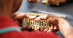 Black Retired Senior Man Playing Domino Game With Friends Stock Photos