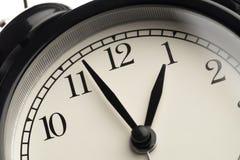 Black retro alarm clock on isolated background,close up stock photography