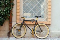 Black retro bike. Black retro bike parking at wall of building Stock Photos