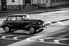 Black retro car. Traveling at speed through the city Stock Photography