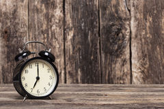 Black retro clock. Showing 07:00 am or pm Royalty Free Stock Photos