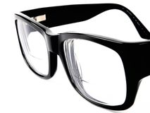 Black retro eyeglasses. Close up on white background Royalty Free Stock Photo