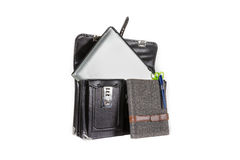 Black retro leather schoolbag with notebook on background Stock Photos