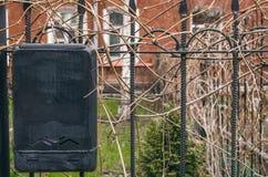 Black retro mailbox on the iron fence. royalty free stock photos