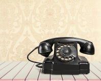 Retro black telephone on  background. Black retro phone telephone call center contact us mint green Stock Photography