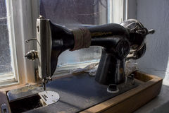 Black retro sewing machine in an old house Stock Images