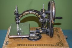 Black retro sewing machine in an old house stock photography