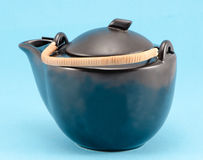 Black retro teapot blue background Stock Images