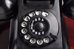 Black retro telephone. Dial disk with Cyrillic letters Stock Photo