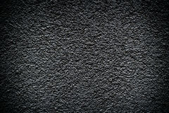 Black revetment wall putty high contrasted with vignetting effect macro texture Stock Photos