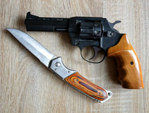 Black revolver pistol with knife Royalty Free Stock Photo
