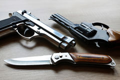 Black revolver pistols with knife Royalty Free Stock Images