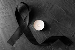 Free Black Ribbon And Burning Candle On Dark  Stone Surface, Top View. Funeral Symbols Stock Photography - 157701852
