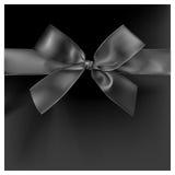 Black ribbon on black color background. Stock Photography