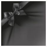 Black ribbon on black color background. Royalty Free Stock Photos