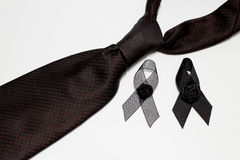 Black ribbon and black necktie; decoration black ribbon hand made artistic design for sadness expression isolated on white backgro Royalty Free Stock Photography