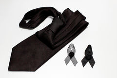 Black ribbon and black necktie; decoration black ribbon hand made artistic design for sadness expression isolated on white backgro Royalty Free Stock Images