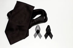 Black ribbon and black necktie; decoration black ribbon hand made artistic design for sadness expression isolated on white backgro Stock Images